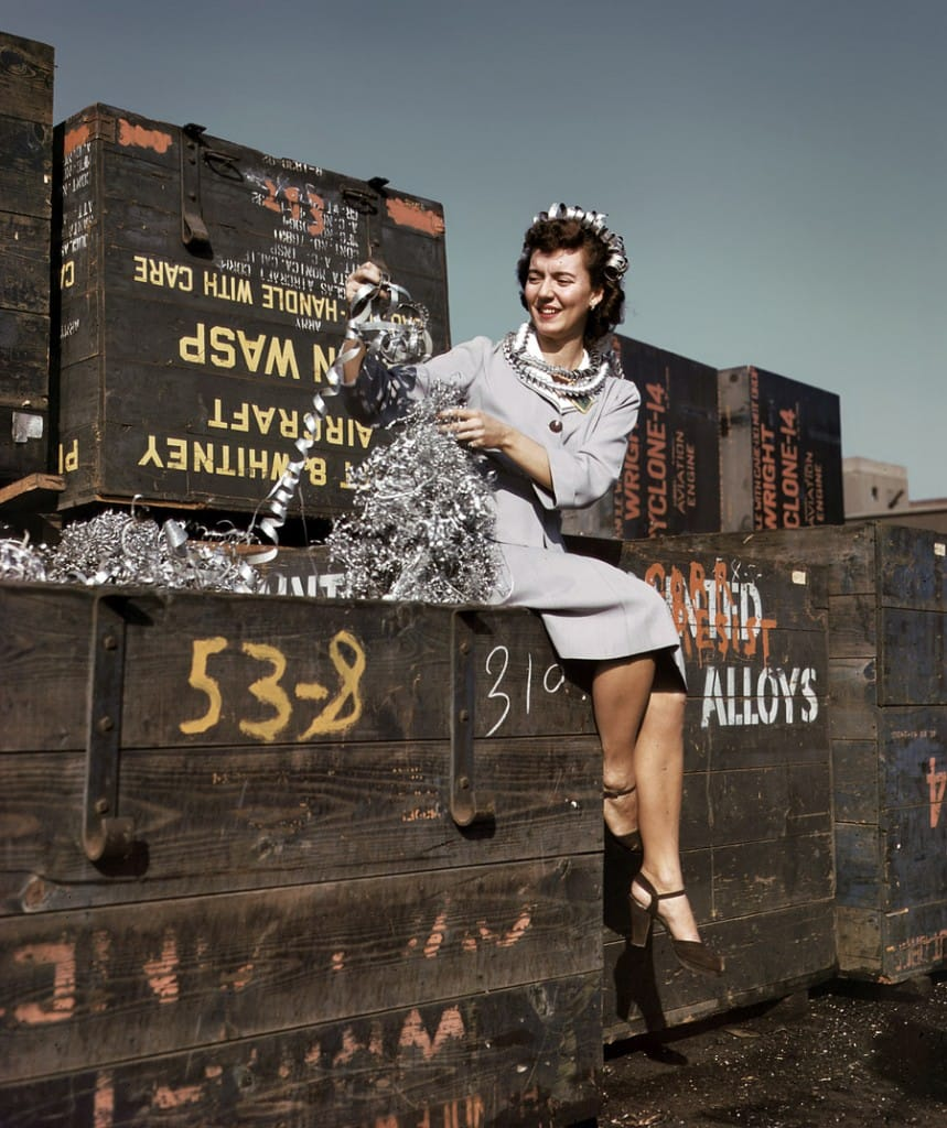 "Long Beach, California. October 1942. ""Annette del Sur publicizing salvage campaign in yard of Douglas Aircraft Company."" 4x5 Kodachrome transparency by Alfred Palmer for the Office of War Information."