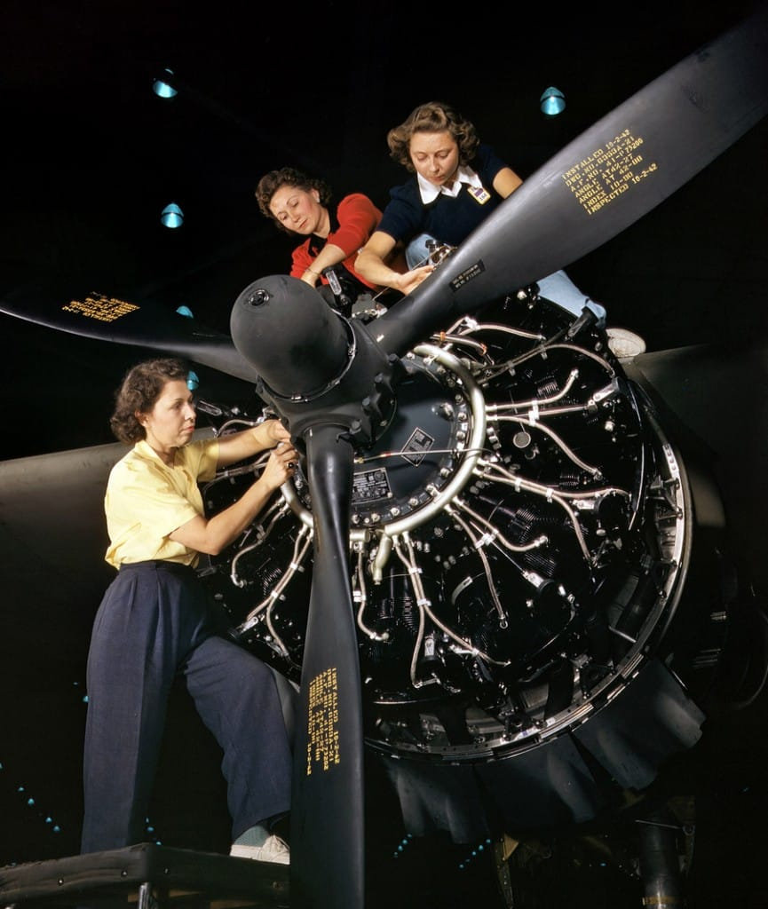 October 1942. Engine installers at Douglas Aircraft in Long Beach, California. 4x5 Kodachrome transparency by Alfred Palmer.