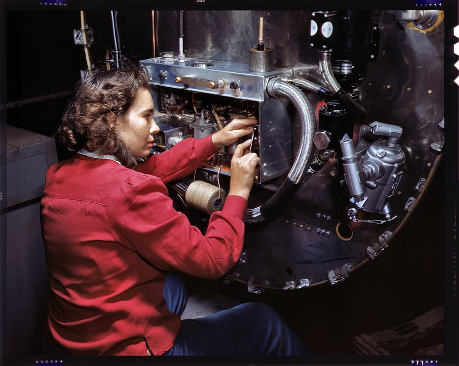 October 1942. Assembling switchboxes on the firewalls of B-25 bombers at North American Aviation's Inglewood, California, factory. 4x5 Kodachrome transparency by Alfred Palmer, Office of War Information.