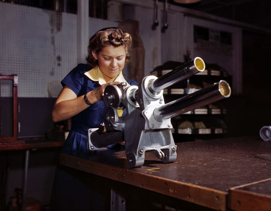 "October 1942. Inglewood, California. ""Young woman employee of North American Aviation working over the landing gear mechanism of a P-51 fighter plane."" 4x5 Kodachrome transparency by Alfred Palmer."