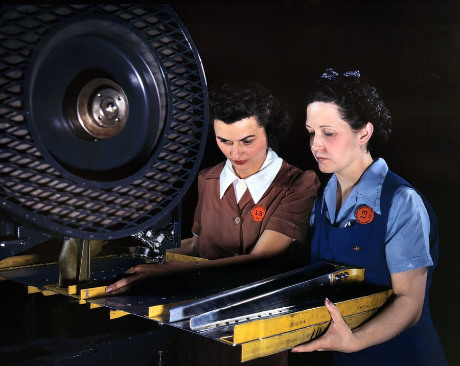 "June 1942. Inglewood, California. ""Punching rivet holes in a frame member for a B-25 bomber at North American Aviation."" 4x5 Kodachrome transparency by Alfred Palmer for the Office of War Information."