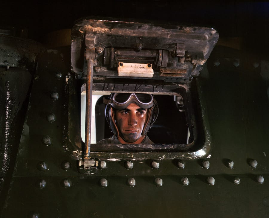 June 1942. Army tank driver at Fort Knox, Kentucky. 4x5 Kodachrome transparency by Alfred Palmer for the Office of War Information
