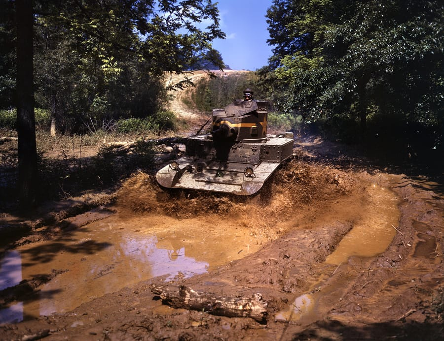 "Fort Knox, June 1942. ""Light tank going through water obstacle."" 4x5 Kodachrome transparency by Alfred Palmer, Office of War Information."