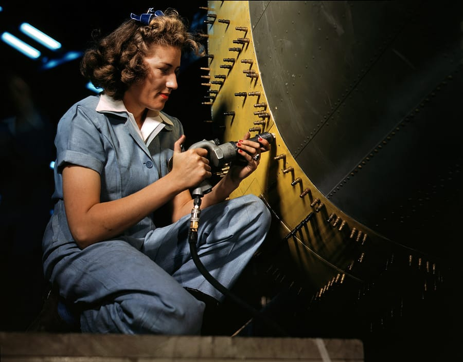 October 1942. Riveter at work on a bomber at the Consolidated Aircraft factory in Fort Worth. 4x5 Kodachrome transparency by Howard Hollem