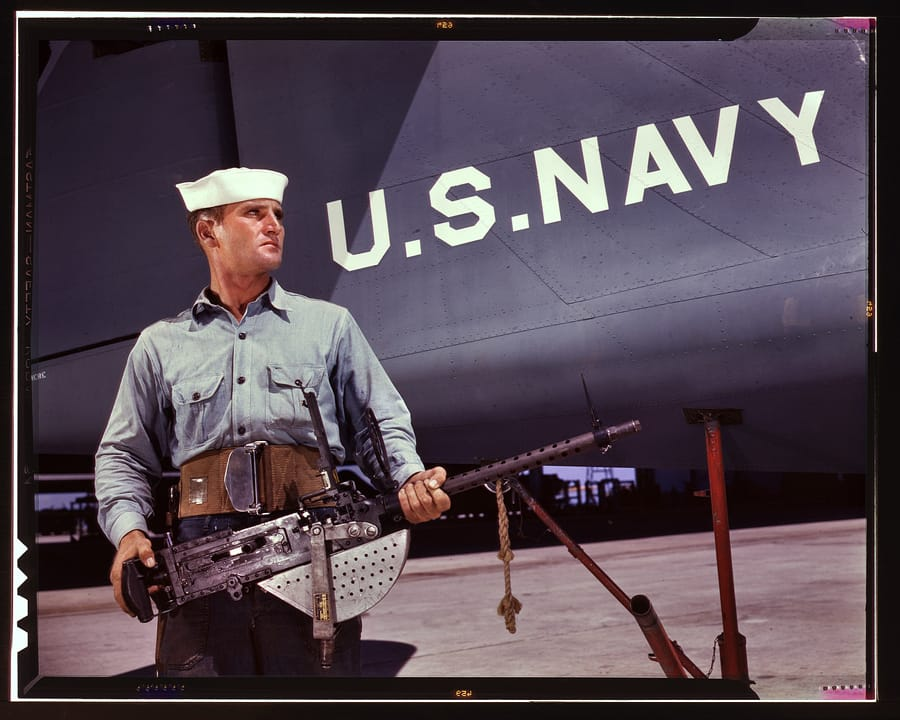 "August 1942. Corpus Christi, Texas. ""After seven years in the Navy, J.D. Estes is considered an old sea salt by his mates at the Naval Air Base."" 4x5 Kodachrome transparency by Howard Hollem, Office of War Information."